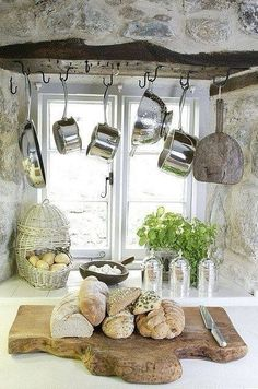This french countryside kitchen is accented with hanging pots and a rustic cutting board with fresh french bread Do you need a little inspiration for your kitchen? These French country kitchens are all stunning examples of country farmhouse style decor. French Country Kitchens, French Farmhouse, Country Farmhouse, Country French, French Style, Rustic Cottage, Country Cottage Kitchens, Cottage Kitchen Decor, French Kitchen Decor