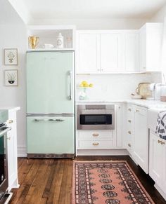 I think the teal fridge and the pink rug go really well with each other