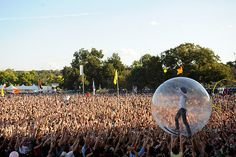 Flaming Lips Crowd Surfing. Impressive skills, almost gives us chills! Who knew bubble boy went concert hopping.
