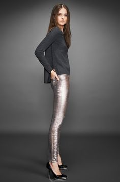 Shop this look on Lookastic:  http://lookastic.com/women/looks/charcoal-crew-neck-sweater-silver-leather-skinny-pants-black-leather-pumps/6154  — Charcoal Crew-neck Sweater  — Silver Leather Skinny Pants  — Black Leather Pumps