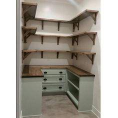Gorgeous walk in pantry with cabinets below and open shelves above. Love how pretty AND functional this is!