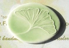 I love the delicate lines on the ginkgo leaf. This lapel pin is a perfect gift for a nature lover. GINKGO LEAF handmade ceramic lapel pin by FaithAnnOriginals, $12.00