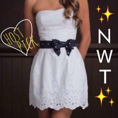 Sweetheart Dress w/Polkadot Bow ✨NWT✨ This pure white sweetheart dress is super cute for any outing. It has a navy and white polkadot bow that snaps together in the front. The bottom has small flower cutout details. While the back has an elastic like back in the dress as well as the bow. NEVER WORN! Hollister Dresses