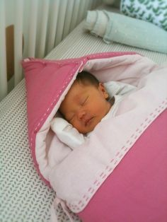 This is Ruby, the Oh Joy baby. Love the comfy duvet she is laying in.