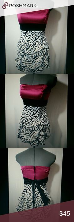 """RUBY ROX Prom Formal Dress sz 5 Raspberry Leopard Individual monitors may display slightly different color or hues...??  RUBY ROX Formal Dress  TAG SIZE: 5 BUST: 28""""-32"""" LENGTH: 26"""" from top of the shoulder down? Beautiful Zebra print tiered skirt Sweetheart bodice Empire waist Above knee length (depending upon your height)StraplessRaspberry pink, black and white in color Minimal wash and wear. Check out my?other items! Ruby Rox Dresses Prom"""