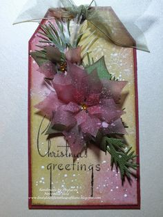 Linda (LindyLou):  Spellbinders Layered Poinsettia Die; Clearly for Art Modeling Film & Tim Holtz Frosted Film; Distress Ink and Spray; Faux Mother of Pearl Bkg.  . . .