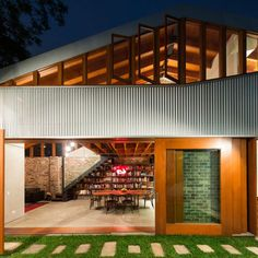 "Australian firm Carterwilliamson Architects converted a 19th-century cow shed into a residence that implements passive heating and cooling principles. ""Our clients share a vision for gregarious family life which is reflected in their home. The spaces are truly 'open plan. Each room is connected to the others and to the sunny, green courtyard that acts as a natural extension of the living spaces,"" says firm principal Shaun Carter.  Photo by: Brett Boardman"