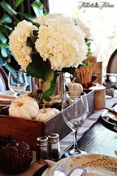A southern classic, hydrangeas, feathers, wheat stalks and silver settings. Get this look for fall and find decorating ideas. MODERN VINTAGE MARKET