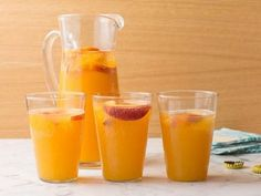 For Giada's Ginger-Peach Beer Cooler, combine peach nectar and fresh summer peaches with light beer for a simple cocktail that's ready to serve a crowd.