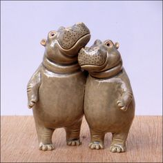 A lovely little couple I made as a demo at a potters fair. They were intended to go to the Hippolotofus reunion with me but got snapped up by potter colleagues even before they were dry More hippos...