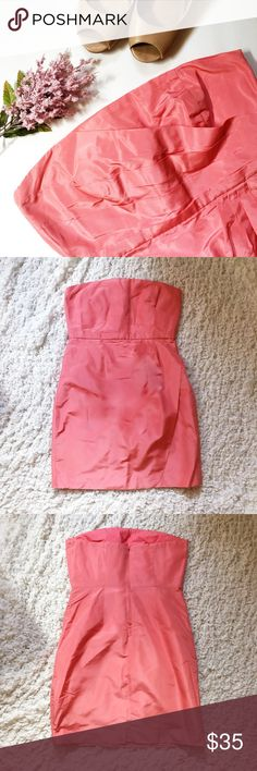 J. Crew Coral Dress Gorgeous J. Crew cocktail dress in great condition. The outer part of the dress is 100% silk. It is fully lined, with the bodice lining being 100% cotton & the skirt lining being 100% Acetate. It measures 17 inches across (armpit to armpit) and 14.5 inches across at the waist. It is 28 inches long from top to bottom. Zipper back. Excellent quality! J. Crew Dresses