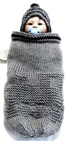 Knitting Pattern for Train Baby Cocoon and Hat - Finished Size: Small baby to 3 months with 2 larger sizes included for both the cocoon and hat. See with other cocoons at http://intheloopknitting.com/baby-sleep-sack-wrap-knitting-patterns/ or go direclty to the pattern on Etsy http://www.awin1.com/cread.php?awinaffid=234273&awinmid=6220&p=https%3A%2F%2Fwww.etsy.com%2Flisting%2F68447881%2Ftrain-cocoon-knitting-pattern-beanie-hat%3Fref%3Drelated-5