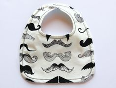 This listing is for one Mustache Waterproof Bib.    Your little man will look so distinguished in the cute patterned bib! Wheres my stache!