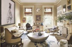 In AD100 interior designer Muriel Brandolini's eclectic Manhattan townhouse, Antipodal Shopperby George Condo is displayed above a midcentury Italian sofa; the cocktail table is by Mattia Bonetti, the vintage light fixture is by Gerrit Rietveld, and the oval portrait is of Muriel's husband, Count Nuno Brandolini, as a child.