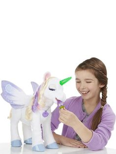 This friendly FurReal Friends StarLily Magical Unicorn will light up play times! Watch as her magical horn lights up in an array of beautiful colours - the more you play, the stronger her powers become.Feed her a Sugarberry treat and finish by braiding and styling her hair. This snuggly, adorable character will make play times truly magical.Useful info: Age from 4 yearsHorn lights upSugarberry treat includedHair can be braided and styledDimensions: 20 x 50 x 44 cmFurReal Friends StarLily…
