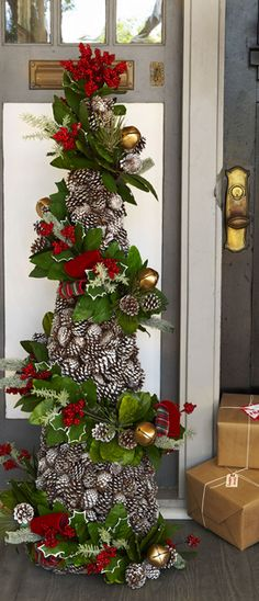 Easy to accomplish with a tomato cage.  Make each separately, greenery garland & pine cone garland, then wire to cage