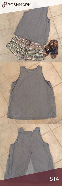 """Gap Tulip Back Grey Top Size S Wore a couple of times, minimal to no signs of wear. Washed in gentle cycle and hung to dry. This slightly cropped top is made of lyocell and is extremely soft, feels like a broken in lightweight chambray. Gorgeous back detailing. See separate listings for shorts and sandals. Approximately 22"""" length and 17"""" at chest laying flat. Smoke free home. No lowball offers, trades, holds, or outside sales. GAP Tops"""