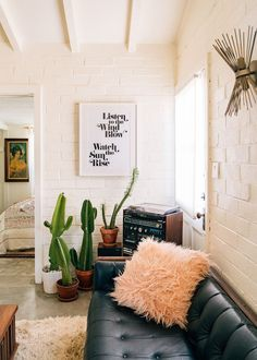This Chic Airbnb Calls For Ditching City Life For The Desert Living Room Home Decor House Decoration Bohemian Boho Cactus Modern Black Leather Couch Small Spaces White Brick Wall Bohemian Living, Boho Living Room, Living Room Decor, Tiny Living, Living Rooms, Modern Living, Bohemian Homes, Modern Bohemian, Modern Room