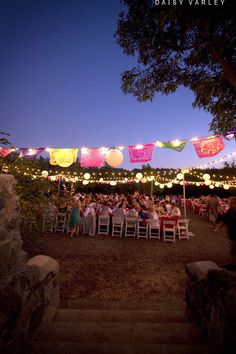 LOVE the lights with the mexican lace banners. Then maybe some luminaries?
