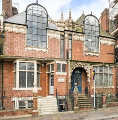 For sale: Margot Fonteyn's Arts and Crafts live-in studio. Once the home of English prima ballerina Margot Fonteyn, this Grade II-listed property in London's West Kensington was designed by Frederick Wheeler in 1891 as one of eight terraced Arts and Crafts dwellings known as St Paul's Studios, famous for their impressive north-facing double-storey windows. Photograph: Featherstone Leigh
