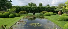 A water feature framed beautifully by lawn and clipped hedges. It draws your eye to a subtle sculpture. Pinned to Garden Design - Water Features by Darin Bradbury of BASK Landscape Design. Residential Landscaping, Modern Landscaping, Garden Landscaping, Garden Paving, Landscaping Ideas, Pool Water Features, Water Features In The Garden, Garden Pool, Water Garden