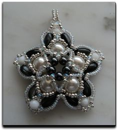 Very pretty and easy star pendant using oval beads.