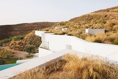 camilo rebelo and susana martins embed ktima house on greek island - designboom | architecture