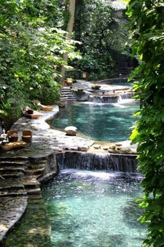 this is next to my dream house in the forest i want to live in natural swimming pool... would love a pool like this with a waterfall and maybe a slide.