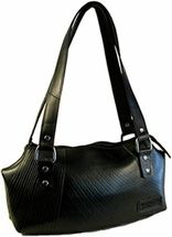 This recycled handbag is handmade from discarded truck and car tire inner-tubes. These fashionable purses are being made by an El Salvadorian group that is providing employment for their community, fair living wages, training and job security. They are collecting inner-tubes that have been accumulated and would be thrown into landfills that pollute the Earth. Each purse has its own distinct markings that come from the factories where the inner tube was manufactured.