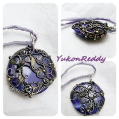 Violet dyed banded agate wrapped in aged sterling silver. Necklace is two sizes and colours of ribbon pulled through titanium wire lace.