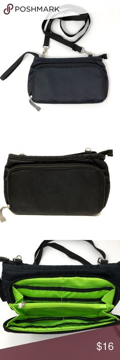 REI Crossbody Wallet Travel Purse Wristlet This sleek little number carries the daily essentials 2 ways: as an ultraslim purse or as a wristlet.  Adjustable shoulder strap is detachable when you choose wristlet mode Main compartment has slots and zip pockets for credit cards, currency & keys Gussets on main compartment hold it open for easy access, yet won't allow it to flop so far open that things spill out Zip outer pocket is sized to fit a phone, lip balm and other essentials 210-denier…