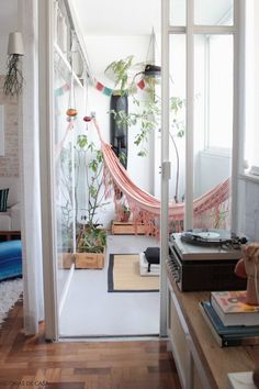 indoor hammock retreat with indoor plants and lots of windows to open up the space
