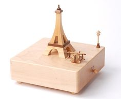 """Our simplistic Eiffel Tower wooden music box is timeless with its natural wood appearance. The plane flies around the Eiffel Tower to """"Au claire de la lune"""". Image Tour Eiffel, Music Notes Decorations, Rose Music, Wooden Music Box, Mozart, Music Crafts, Music Festival Fashion, Music And Movement, Kraft Gift Boxes"""