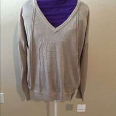 Liz Claiborne Sparkle Sweater This is brand new with tags.  It is a V-neck, long sleeve, sparkle sweater.  It looks like a sweater but is not heavy.  It has a silky flow to it.  It has a sparkle that is in the material.  Very glamorous. Liz Claiborne Sweaters V-Necks