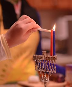 Thanksgivukkah Day 2 - The Next Generation of Christian Zionists by Wayne Wong on Capture Kern County // My wife's niece lights the candles on Thursday night, and learns about Channukah.  She also learned how to say Jerusalem in Hebrew:  Yerushalyim.