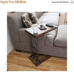 3-IN-1 Industrial C-Table. Functions as a Side Table, a Computer Desk, and Couch Table/Coffee Table, perfect for cuddling on the couch next to your favorite person, within easy reach of your drinks and snacks. Extremely sturdy yet lightweight enough to move like silk across your living room floor. Made of 100% Natural Pine Wood and Industrial Pipe & Fittings DIMENSIONS: 25.5 tall from floor to the top of the table 24 clearance from floor to the bottom of the table TOP: 12 wide x 18 long…