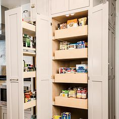 Kelley opted mostly for lower drawers instead of cupboards, open shelves instead of closed cabinetry, and storage pantries fitted with pull-...