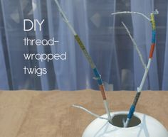 colorful twigs centerpiece by #collectandcarry