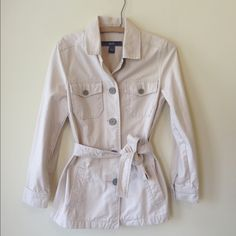SOLDBeige GAP jacket Mint condition. Beige khaki jacket coat. Buttons down the front and has chest and side pockets. Longer in length. Buttons at the bottom of the sleeves. Has a belt that can be tied at the waist. Has a collar. Size small by GAP. Perfect for winter! GAP Jackets & Coats