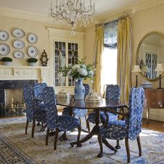 blue and creamy yellow dining room with built-in china cabinet and fireplace