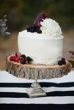 In keeping with a beautiful jewel tone theme simply add purple and red fruit to your wedding cake.