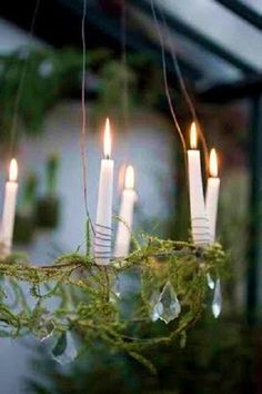my husband is going to make a two tier wire candle chandelier to hang on our balcony...this is kind of cute too...