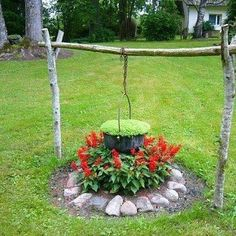 Blooming dutch oven hanging over 'fiery' flowers - great idea!