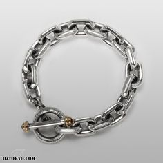 Shackles GoldTips (Garnet) « The ultimate in high-end rock fashion; this is a one of a kind chunky chain bracelet that combines luxury and urban chic. Dark and decadent, Shackles lends instant rock 'n' roll style to any outfit or occasion...