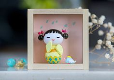 Kioko . Kokeshi doll no. 8    Kioko (happy child) is the 8th doll in my kokeshi series. She and her tiny bird are handmade by me with lots of