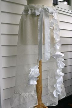 Ruffled curtain panel redesigned into beach cover up skirt, open in the front.  Upcycle, recycle, diy, salvage, repurpose!  For ideas and goods shop at Estate ReSale  ReDesign, Bonita Springs, FL