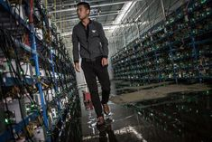 Tibetan bitcoin mine manager Kun walks between aisles of mining machines. Kun is the mine's manager as well as one of its investors. He learned about bitcoin through a friend and started investing in [EPA/Liu Xingzhe/CHINAFILE] Bitcoin Mining Software, Bitcoin Mining Rigs, What Is Bitcoin Mining, Montana, Bitcoin Mining Hardware, Mining Pool, Coin Prices, Crypto Mining, Tecnologia
