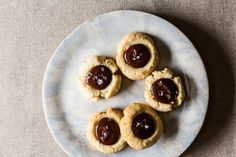 Almond Thumbprint Cookies with Dark Chocolate and Sea Salt  Add a little raspberry jam before the chocolate