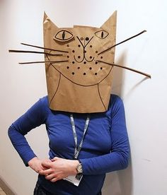 Well, the cat's outta the bag, literally! This cat paper bag Halloween costume is super cute. Grab a paper bag, cut out eye holes and let your creativity take over with fun additions for the face. Great for kids too! Easy Costumes, Halloween Costumes, Costume Ideas, Diy Halloween, Happy Halloween, Diy Paper Bag, Paper Art, Paper Crafts, Cat Mask