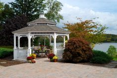 A quiet place for morning tea under the vinyl gazebo with a pagoda roof and cupola. Visit Gazebo.com